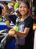 Boy Having Fun Celebrating Songkran 2014 in Bangkok, Thailand. Thai boy shooting water and having fun on Khao San Road celebrating the traditional Thai New Year Royalty Free Stock Photo