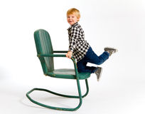 Boy Having Fun On Chair Stock Images