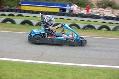 Boy having fun on a go cart. Summer season Stock Image