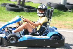 Boy having fun on a go cart. Summer season Stock Photo