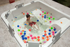 Boy having fun in jacuzzi Stock Photo