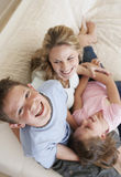 Boy Having Fun With Mother And Sister On Sofa Royalty Free Stock Images