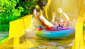 Free Boy Having Fun On Yellow Water Slide At Water Park Stock Photo - 161656060
