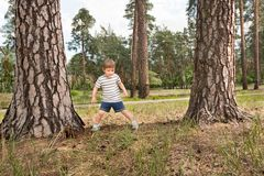 Free time from school. Spare time concept, Positive emotions effect. Boy having fun outdoor. Boy is waiting for the ball from friend. Free time from school royalty free stock images