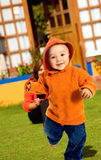 Boy having fun outdoors Stock Images