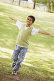 Boy having fun in park Royalty Free Stock Photography