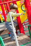 Boy having fun in playground Royalty Free Stock Photos