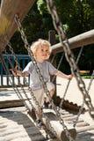 Boy having fun on the playground Stock Photo