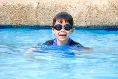 Boy having fun in the pool Royalty Free Stock Image