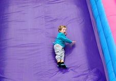 Boy Having Fun on Slide Stock Image