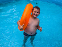 Boy in having fun in the swimming pool. Little boy in having fun in the swimming pool Royalty Free Stock Photos