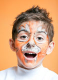 Boy having fun in tiger make-up Royalty Free Stock Photos