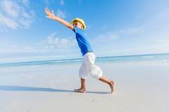 Boy having fun on tropical ocean beach. Kid during family sea vacation. Stock Photos