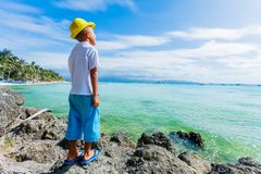 Boy having fun on tropical ocean beach. Kid during family sea vacation. Stock Photo