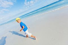 Boy having fun on tropical ocean beach. Kid during family sea vacation. Royalty Free Stock Images