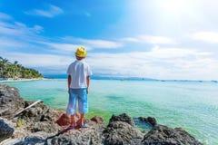 Boy having fun on tropical ocean beach. Kid during family sea vacation. Stock Image