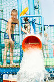 Boy having fun with water bucket Stock Images