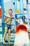 Boy having fun with water bucket Royalty Free Stock Photos