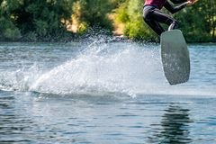 Boy having fun with waterski on the lake royalty free stock photography
