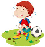 Boy having graze from playing football. Illustration vector illustration