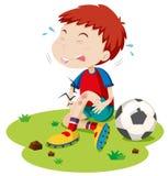 Boy having graze from playing football Stock Photo