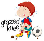 Boy having grazed knee Royalty Free Stock Photos