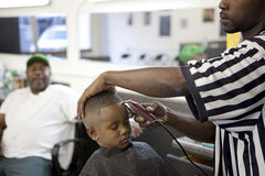 A boy having a haircut, Mississippi. A boy having his haircut in a barber shop, Mississippi Royalty Free Stock Photos