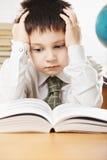Boy having hard reading Royalty Free Stock Image