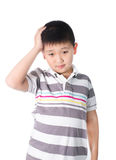 Boy having a headache holding his head with his hand, isolated on the white background Royalty Free Stock Photography