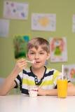 Boy having healthy diet Stock Photography