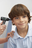 Boy Having His Ear Examined Stock Photo