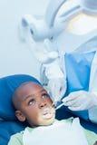 Boy having his teeth examined by dentist Stock Photo