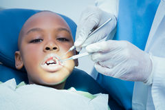 Boy having his teeth examined by dentist Stock Images