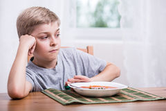 Boy having no appetite. Young boy having no appetite for dinner Royalty Free Stock Photos