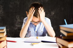 Boy having problems in finishing homework. At home stock images