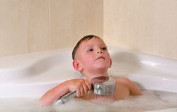 Boy having a relaxing bath Royalty Free Stock Image