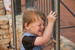 Boy is having a shower Stock Photography
