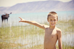 Boy having Summer Fun at the Lake Royalty Free Stock Images