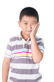 Boy having a toothache holding his face with his hand, isolated on the white background Stock Images
