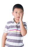 Boy having a toothache holding his face with his hand, isolated on the white background Royalty Free Stock Images