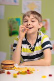Boy having unhealthy diet Stock Image