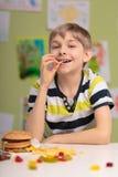 Boy having unhealthy diet Stock Image