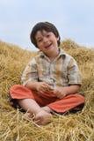 The boy  on hay Stock Photo