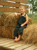 Boy on hay ride. Young tennessee boy on bales of straw in overalls Royalty Free Stock Photos