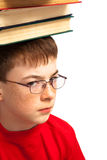 Boy on head with books Stock Photography