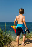 Boy heading to the beach Stock Image