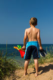 Boy heading to the beach Royalty Free Stock Images