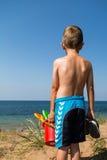 Boy heading to the beach Stock Photo