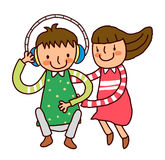 Boy with headphone and girl. Sitting beside Royalty Free Stock Image