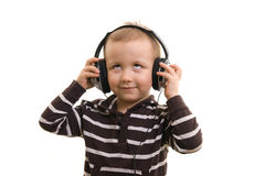 Boy with Headphones. Boy on with background with headphones Stock Photo